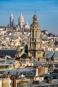Rooftops of Paris with the Sacre Coeur Basilica in Montmartre and Trinity Church. 18th Arrondissement Paris France poster