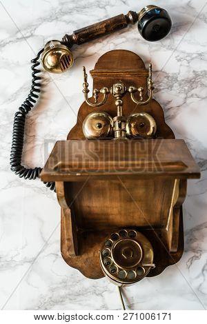 Antique Magneto Hand Crank Telephone Set On Marble Background