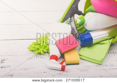 Spring Cleaning Concept. Cleaning Supplies On Wood Background.