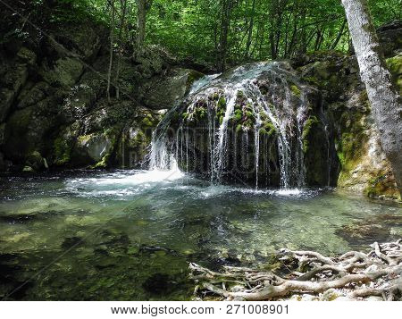 Beautiful Waterfall With Natural Pool In The Mountin Forest. Cascading River On Crimean Mountains At