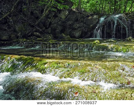 Cascading River With Beautiful River Thresholds And Waterfall In The Green Spring Forest. Crimean Mo