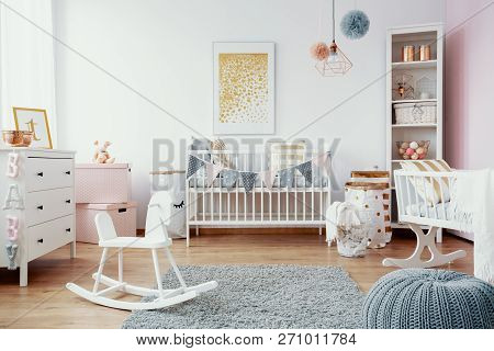 Bright Baby Room With White Furniture, Grey Carpet On The Floor And Golden Painting On The Empty Wal