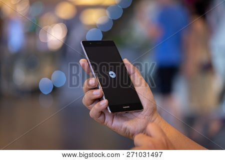 Chiang Mai, Thailand - Oct. 28,2018: Man Holding Huawei With Uber Apps. Uber Is Smartphone App Trans