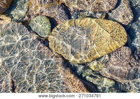 Close Up Of Clear Water Of Mountain River With Underwater Stones