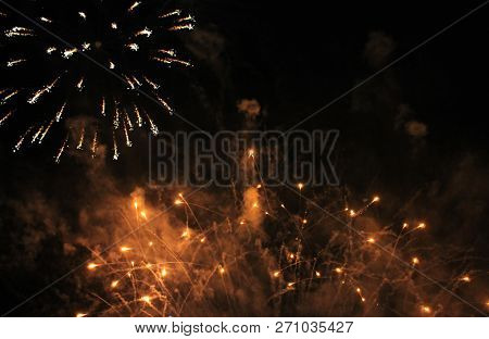 Fireworks. Firework. Heavenly Background. A Colorful Wave Of Bright, Shimmering, Luminous Glittering