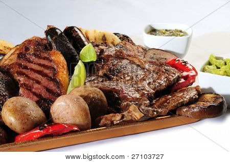 Variety of barbecued meats and vegetables.