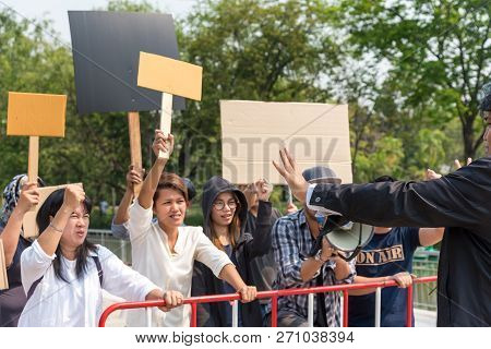 Bangkok, Thailand- 10 March 2018 : Men And Women Share A Protest Sign Holding A Megaphone. Mob Conce