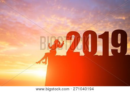 Silhouette Of Business Woman Sit On The Cliff With 2019