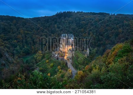 Eltz Castle At Dusk - Famous Hilltop Castle Nested In The Forest Hills Above The Moselle River Betwe
