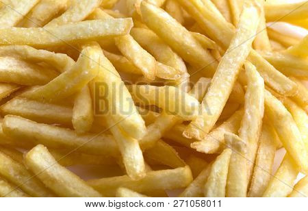 French Fries Close-up. A Pile Of Fried French Fries Close-up.