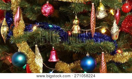 Image Of Many Toys On Green Christmas Firtree