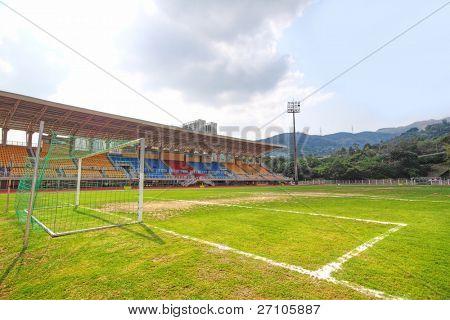 Soccer stadium , green grass and sky