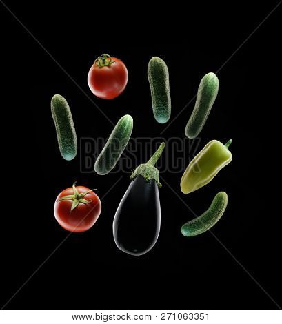 Vegetables on black background. Tomato, green pepper, cucubber and eggplant.