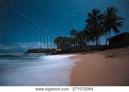 Beautiful Tropical Island Paradise Scenic View With Starry Night Sky With Palm Tree Silhouette With