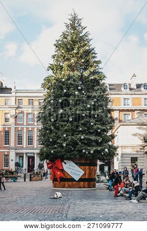 London, Uk - November 21, 2018: Giant Christmas Tree In A Pot With A Gift Tag In Front Of Covent Gar