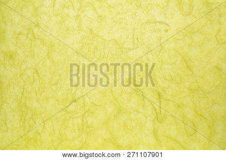 background of green textured handmade mulberry paper
