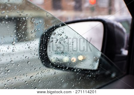 Winter Driving And Snow Storm Conceptual Image With Room For Copy Space Closeup Window With Water Dr