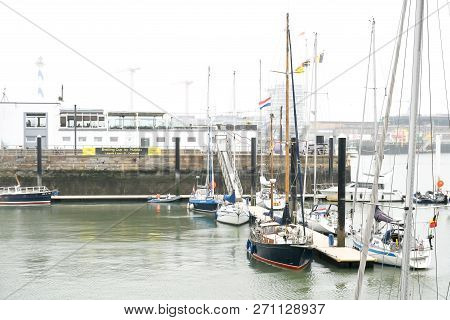 Oostende-belgium, August 15,2018 : Environment Oostende Port  In Rainny And Foggy Day With Fishing B