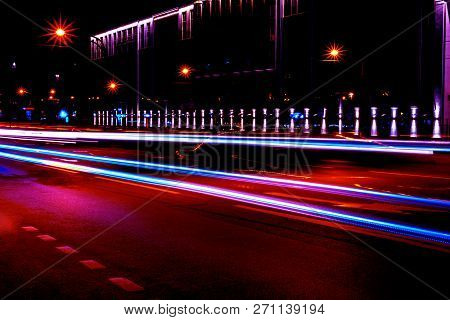 Cars Light Trails On A Curved Highway At Night. Night Traffic Trails. Motion Blur. Night City Road W