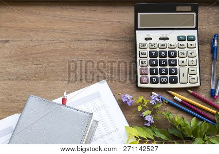 Notebook Planner ,financial Statement And Calculator For Business Work On Background Wooden At Offic