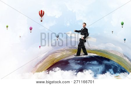 Conceptual Image Of Young Successful Business Man In Suit Pointing Aside By Means Of Big White Banne