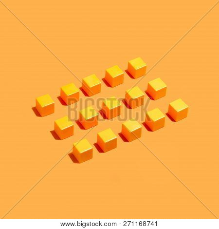 Rows Of Yellow Identical Cubes On Yellow Background. Minimal Style. Symbolic Concept Of Conformism,