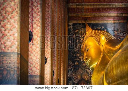 Statue Of Sleep Buddha Or Reclining Buddha In Wat Pho Temple In Bangkok, Thailand