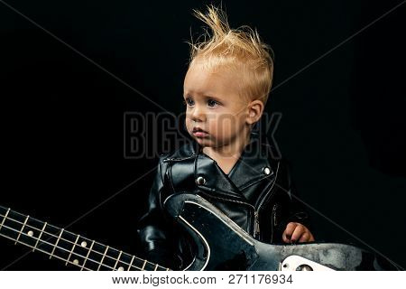 Never Stop Rock And Roll. Small Musician. Little Guitarist In Rocker Jacket. Little Rock Star. Child