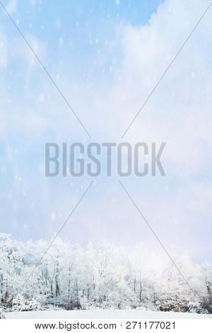 Snow Falling Softly Against A Blurred Background Of Winter Landscape Of Snow Covered Trees With Larg