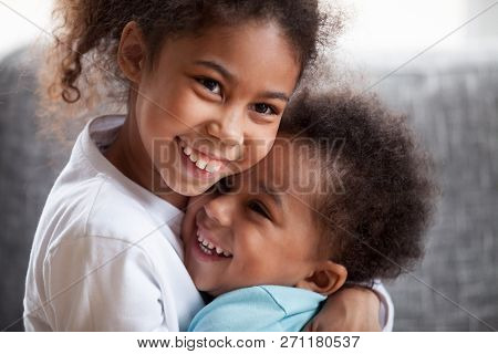 Happy African American Siblings Embracing, Sitting Together