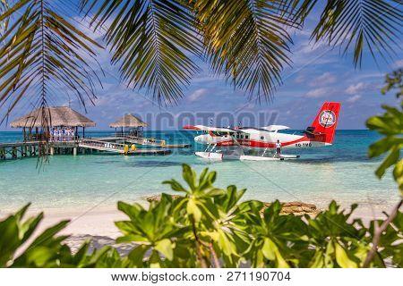 05.06.2018 - Ari Atoll, Maldives: Exotic Scene With Seaplane On Maldives Sea Landing. Vacation Or Ho
