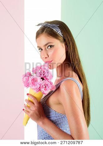 Pretty Girl In Vintage Style. Retro Woman Eating Ice Cream From Flowers. Pin Up Woman With Trendy Ma