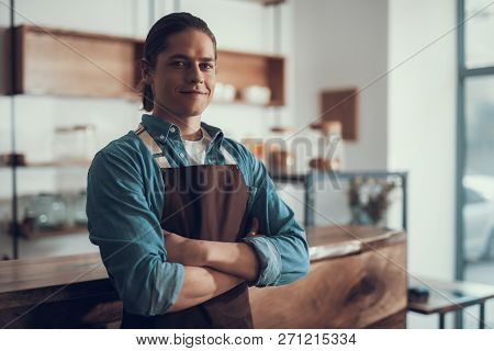 Waist Up Of Confident Waiter Standing Alone And Smiling