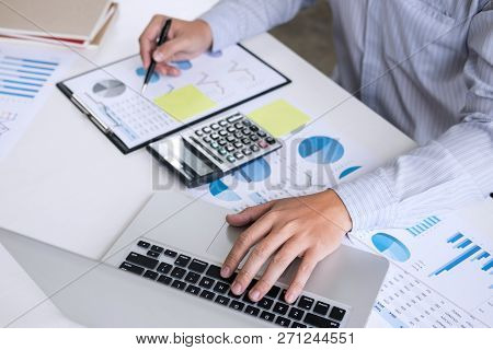 Business Accountant Or Banker, Businessman Calculate And Analysis With Stock Financial Indices And F