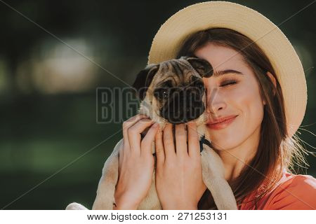 Young Dogs Owner Is Gently Hugging Her Pet