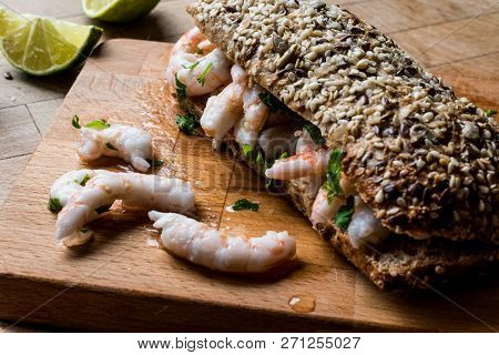 Shrimp Sandwich With Lime On Wooden Surface.