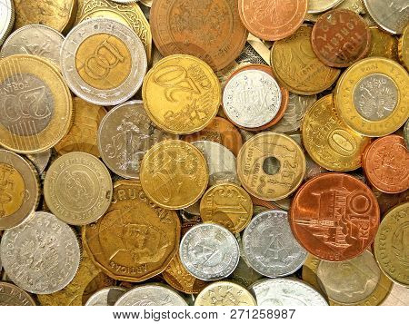 Close up top view image of large amount of old money coins of different countries and times on dolla