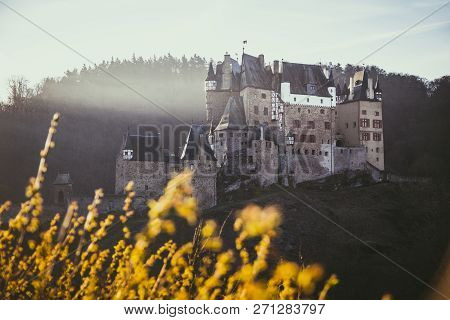 Beautiful View Of Famous Eltz Castle In Scenic Golden Morning Light At Sunrise In Fall, Wierschem, R