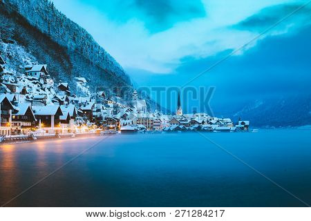 Panorama View Of Famous Hallstatt Lakeside Town In The Alps In Mystic Twilight During Blue Hour At D
