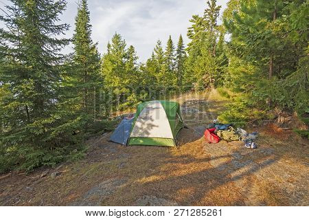Wilderness Campsite in the North Woods on Emerald Lake in Quetioc Provincial Park in Ontario poster