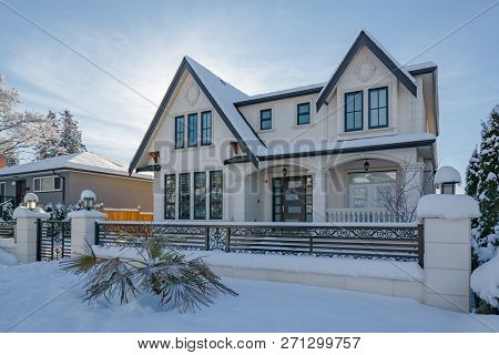 Luxurious Residential House With Front Yard In Snow. North American Family House On Winter Sunny Day