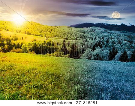 Time Change Above Mountainous Countryside In Springtime. Grassy Meadows And Forested Hill. Freshness