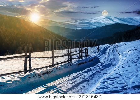 Time Change Concept. Country Road In To The Winter Mountains. Wooden Fence Along The Road. Composite