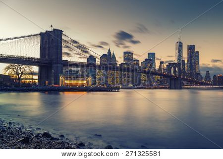 Brooklyn bridge East river and Manhattan after sunset, New York City