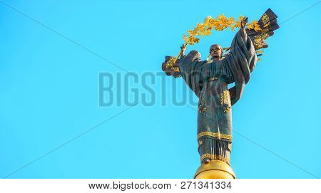 Monument Of Independence Of Ukraine In Front Of Blue Sky. The Monument Is Located In The Center Of K