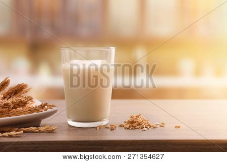 Spelled Drink In Containers With Spikes On A Wooden Table In A Rustic Kitchen. Horizontal Compositio