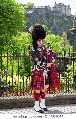 Edinburgh, Scotland - May 19: Scottish Piper Playing On Bagpipe In The Centre Of City On May 19, 201