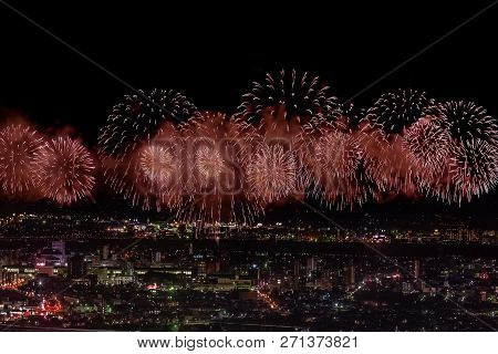 Festive Salute In The Night Sky. Salute Over The City The Megalopolis. Explosions Of Fireworks.