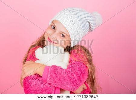Kid Cute Girl Play With Soft Toy Teddy Bear Pink Background. Child Small Girl Playful Hold Teddy Bea
