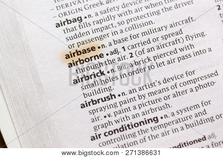 The Word Or Phrase Airbase In A Dictionary Highlighted With Marker.